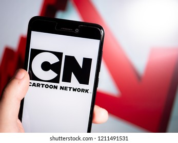 Murcia, Spain; Oct 23, 2018: Cartoon Network logo in phone with losses graphic on background. First person view