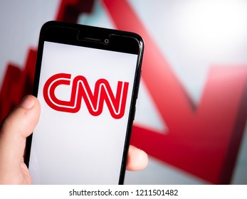 Murcia, Spain; Oct 23, 2018: CNN red logo in phone with losses graphic on background. First person view