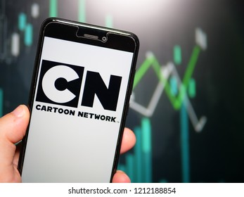 Murcia, Spain; Oct 23, 2018: Hand holding phone with Cartoon Network logo displayed in it with fluctuating graphic on background