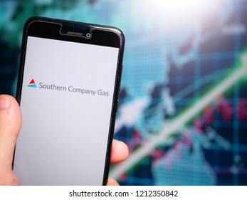 Murcia, Spain; Oct 23, 2018: Southern Company logo in phone with earnings graphic on background. Southern Company Gas is an American energy services holding company