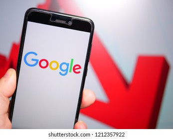Murcia, Spain; Oct 23, 2018: Google LLC logo in phone with losses graphic on background. First person view