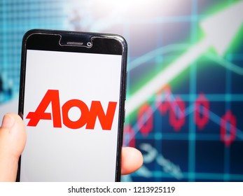 Murcia, Spain; Oct 23, 2018: Aon PLC logo in phone with earnings graphic on background. Aon plc is a global professional services firm that provides risk, retirement and health consulting