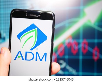 Murcia, Spain; Oct 23, 2018: Archer Daniels Midland Company (ADM) logo in phone with earnings graphic on background. The Archer Daniels Midland Company (ADM) is an American global food processing