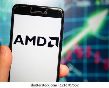 Murcia, Spain; Oct 30, 2018: Advanced Micro Devices (AMD) logo in phone with earnings graphic on background. Advanced Micro Devices (AMD) is an American multinational semiconductor company
