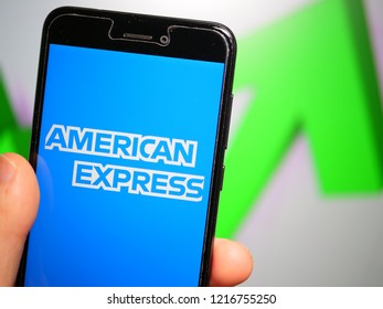 Murcia, Spain; Oct 30, 2018: American Express (Amex) logo in phone with rises graphic on background. First person view
