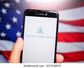 Murcia, Spain; Oct 30, 2018: American Securities LLC logo in phone with United States flag on background. American Securities LLC is a leading U.S. private equity firm that invests in market-leading