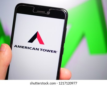 Murcia, Spain; Oct 30, 2018: American Tower Corporation (ATC) logo in phone with rises graphic on background. First person view