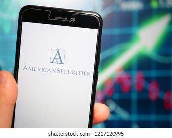 Murcia, Spain; Oct 30, 2018: American Securities LLC logo in phone with earnings graphic on background. American Securities LLC is a leading U.S. private equity firm that invests in market