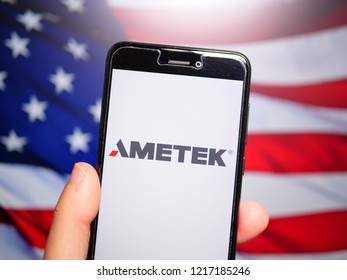 Murcia, Spain; Oct 30, 2018: Ametek logo in phone with United States flag on background. Ametek is an American global manufacturer of electronic instruments and electromechanical devices