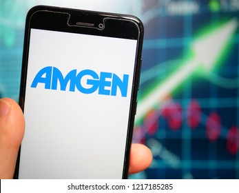 Murcia, Spain; Oct 30, 2018: Amgen logo in phone with fluctuating graphic on background. Amgen is an American multinational biopharmaceutical company
