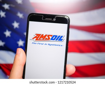 Murcia, Spain; Oct 30, 2018: Amsoil Corporation logo in phone with United States flag on background. Amsoil is a corporation that primarily formulates and packages synthetic lubricants and filters
