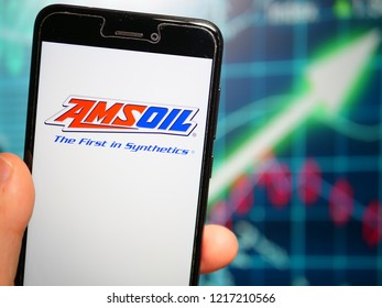 Murcia, Spain; Oct 30, 2018: Amsoil Corporation logo in phone with earnings graphic on background. Amsoil is an American company that primarily formulates and packages synthetic lubricants and filters