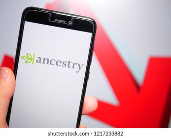 Murcia, Spain; Oct 30, 2018: Ancestry LLC logo in phone with losses graphic on background. First person view