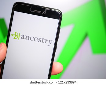 Murcia, Spain; Oct 30, 2018: Ancestry LLC logo in phone with rises graphic on background. First person view