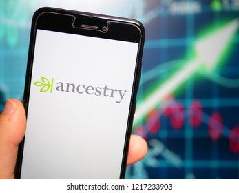 Murcia, Spain; Oct 30, 2018: Ancestry LLC logo in phone with earnings graphic on background. Ancestry.com LLC is The largest for-profit genealogy company in the world
