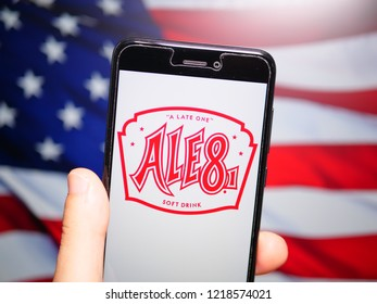 Murcia, Spain; Oct 30, 2018: Ale-8 logo in phone with United States flag on background. Ale-8-One, known colloquially as Ale-8, is a regional ginger- and citrus-flavored soft drink