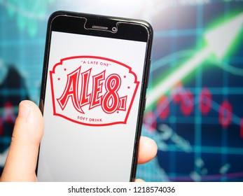 Murcia, Spain; Oct 30, 2018: Ale-8 logo in phone with earnings graphic on background. Ale-8-One, known colloquially as Ale-8, is a regional ginger- and citrus-flavored soft drink