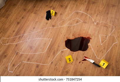 murder, kill and forensic evidence concept - chalk outline of body and knife in blood lying on floor at crime scene