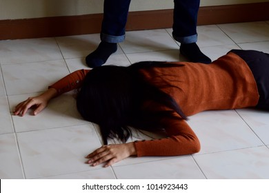 murder, kill and people concept - criminal or murderer with knife and dead woman body lying on floor at crime scene