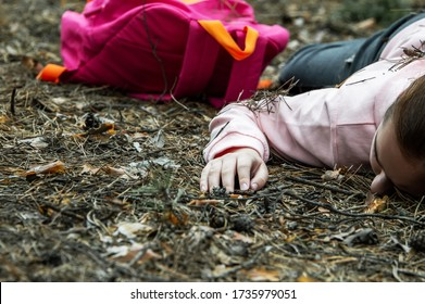 Murder in the woods.The body of a teenage girl in a tracksuit lies on the ground in the woods. Victim of violence. The concept of child abduction. Horizontal photo. Close up.