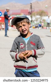 Murghab, Tajikistan, August 23 2018: A Tajik child poses in the street of Murghab along the route of the Pamir Highway
