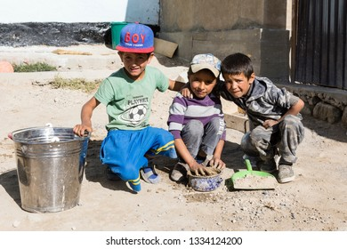 Murghab, Tajikistan, August 23 2018: Three Tajik children pose in front of their home in Murghab along the route of the Pamir Highway
