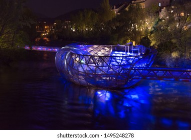 The Murinsel bridge in Mur river at night, in Graz  Austria.