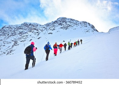 Murmansk region, Russia - April 08, 2013: group of tourists climbing to the mountain pass during their ski hike in the beautiful but harsh mountains of the Arctic, Hibiny