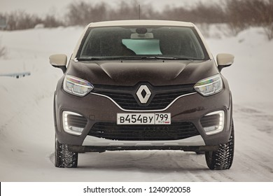 Murmansk Region, Russia - March 2018: Renault Captur class suv on a snowy road in the winter in the snowfall. Northern driving conditions are very dangerous. Front view
