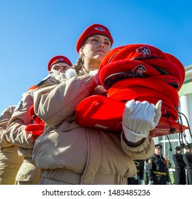 Murmansk, Russia - April 22, 2019: The cadets carry in their hands piles of uniform berets for initiation into the Unarmeitsa