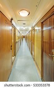 "MURMANSK, RUSSIA - FEB 17, 2016: Interior of the Soviet atomic icebreaker ""Lenin"". A long corridor with cabins"