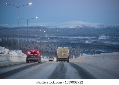 MURMANSK, RUSSIA - FEBRUARY 21, 2019: Winter evening on the Kola highway. Surroundings of Murmansk