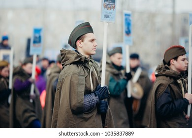 Murmansk, RUSSIA - MAY 9, 2017: Immortal regiment procession in Victory Day. Thousands of people marching to Square with flags and portraits in commemoration of soldiers of World War II