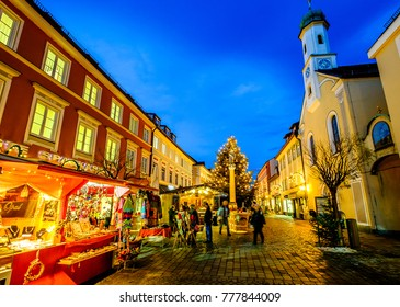 MURNAU, GERMANY - DECEMBER 12: people and stands at the famous christmas market on December 7, 2017 in Murnau, Germany