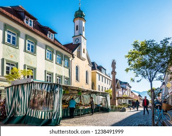 Murnau - Germany, November 14: people visiting the traditional weekly market with kiosks in the old town on November 14, 2018 in murnau, Germany