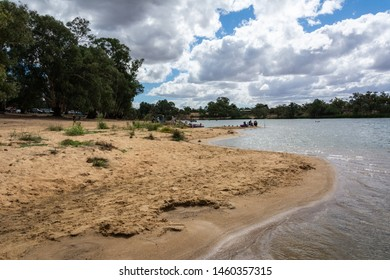Murray River bank in Mildura, Australia, with unidentifiable figures of people.