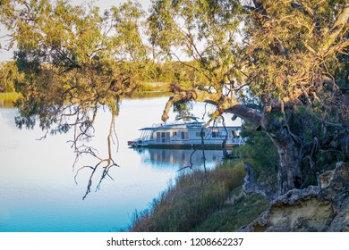 Murray River, South Austraila - Jun 8 2006: A modern houseboat moored up for the night near Blanchetown. Houseboat holidays are very popular in Australia.