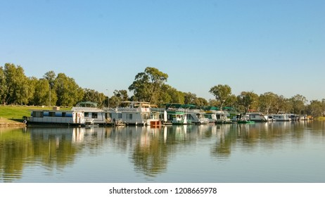 Murray River, South Austraila - Jun 7 2006:  A row of Modern houseboats moored up near Blanchetown. Houseboat holidays are very popular in Australia.