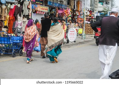 Murree, Pakistan. October 15, 2015 : Pakistani people in salwar kameez traditional dress walking at the shopping street.