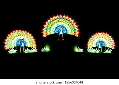 MURRELLS INLET, SOUTH CAROLINA; JULY 4, 2018; A Festival of Lights Peacock display during a Summer evening at the Brookgreen Gardens just outside of Myrtle Beach, South Carolina in Murrells Inlet.