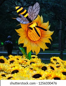 MURRELLS INLET, SOUTH CAROLINA, USA; JULY 4, 2018; A Festival of Lights Bee and Sunflower display during a Summer evening at the Brookgreen Gardens just outside of Myrtle Beach, South Carolina
