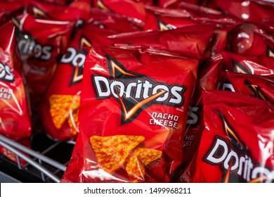 Murrieta, California/United States - 09/04/2019: Several small bags of Doritos Nacho Cheese tortilla chips on a shelf at a convenient store