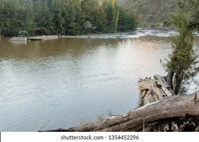 The Murrumbidgee River, looking downstream across a weir at Casuarina Sands Reserve, Canberra, Australia during the morning of March 2019