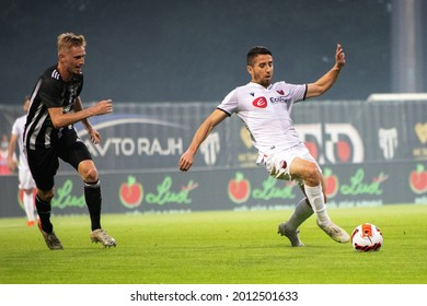 MURSKA SOBOTA, SLOVENIA - July 13, 2021: Žan Karničnik of NS Mura and Ljupche Doriev of KF Shkëndija during the UEFA Champions League first qualifying round, 2nd leg match