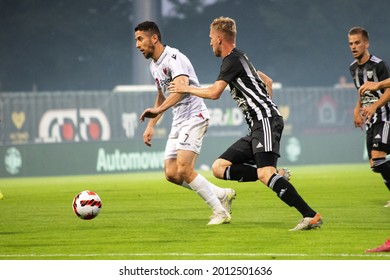 MURSKA SOBOTA, SLOVENIA - July 13, 2021: Žan Karničnik of NS Mura and Besart Ibraimi of KF Shkëndija during the UEFA Champions League first qualifying round, 2nd leg match