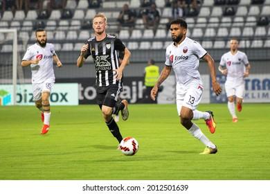 MURSKA SOBOTA, SLOVENIA - July 13, 2021: Žan Karničnik of NS Mura and Igor Wanderson of KF Shkëndija during the UEFA Champions League first qualifying round, 2nd leg match