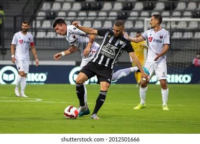 MURSKA SOBOTA, SLOVENIA - July 13, 2021: Nino Kouter of NS Mura and Ljupche Doriev of KF Shkëndija during the UEFA Champions League first qualifying round, 2nd leg match