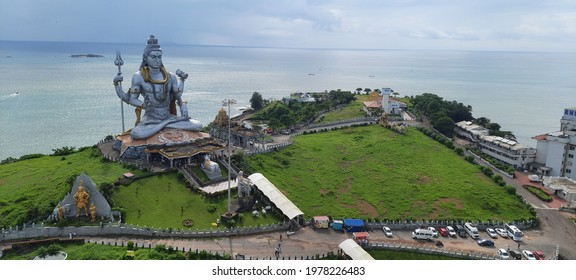 murudeshwar temple with it's beautiful scenerio of beach with green lushes and monuments and lord shiva  - Shutterstock ID 1978226483