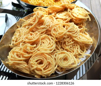 """Murukku is a savoury, crunchy snack came from the Indian subcontinent, popular in southern India and Sri Lanka. The snack's name derives from the Tamil word for """"twisted"""", which refers to its shape."""