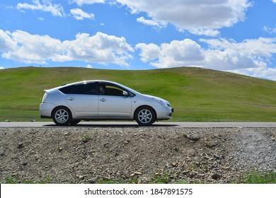 Murun, Mongolia - JUNE 17, 2018: Toyota Prius hybrid hatchback compact car parked in Murun, Mongolia.